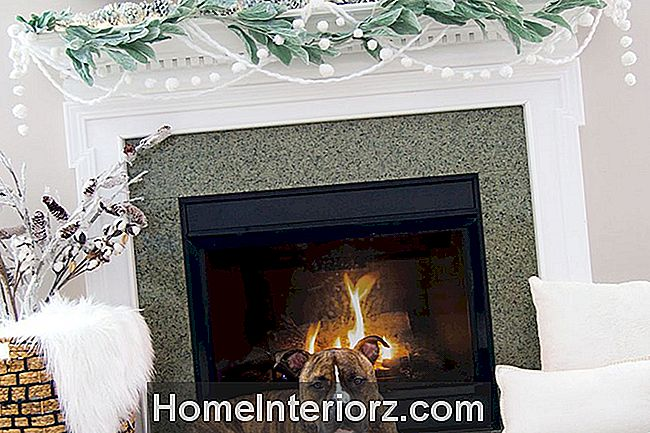 pom pom vinter mantel med evergreens
